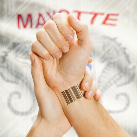 mayotte: Barcode ID number on wrist of a human and national flag on background series - Mayotte Stock Photo