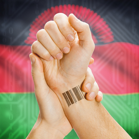 malawian flag: Barcode ID number on wrist of a human and national flag on background series - Malawi