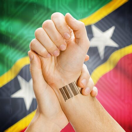 saint mark's: Barcode ID number on wrist of a human and national flag on background series - Saint Kitts and Nevis Stock Photo