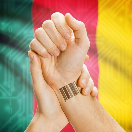 cameroonian: Barcode ID number on wrist of a human and national flag on background series - Cameroon