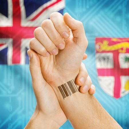 fijian: Barcode ID number on wrist of a human and national flag on background series - Fiji