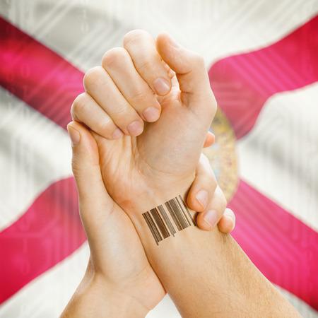 floridian: Barcode ID number tatoo on wrist and USA statesl flag on background series - Florida