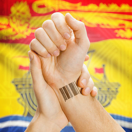 breaking the code: Barcode ID number tatoo on wrist and Canadian province flag on background series - New Brunswick