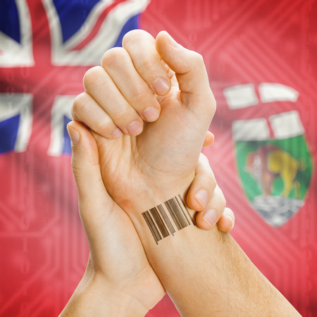 manitoba: Barcode ID number tatoo on wrist and Canadian province flag on background series - Manitoba