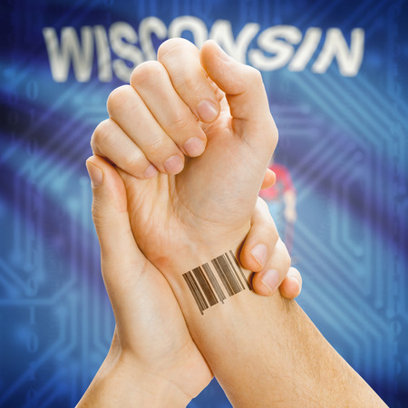 wisconsin flag: Barcode ID number tatoo on wrist and USA statesl flag on background series - Wisconsin