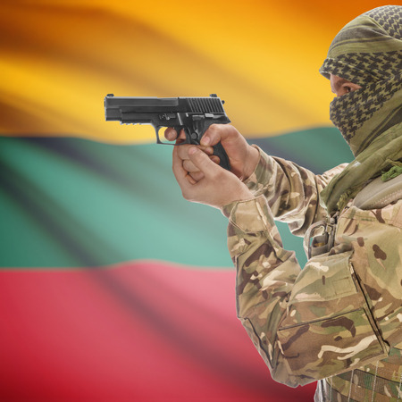 insurgency: Man with gun in hand and national flag on background series - Lithuania Stock Photo