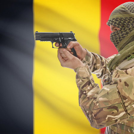 counterterrorism: Man with gun in hand and national flag on background series - Belgium