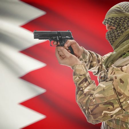 counterterrorism: Man with gun in hand and national flag on background series - Bahrain