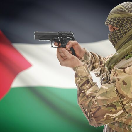 national police agency: Man with gun in hand and national flag on background series - Palestine
