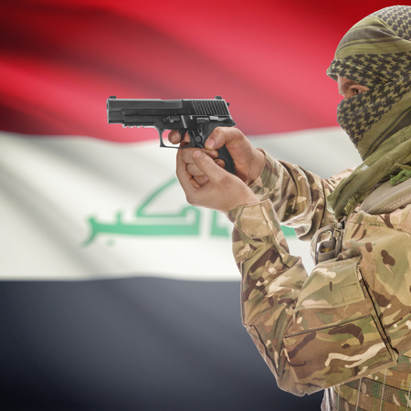 counterterrorism: Man with gun in hand and national flag on background series - Iraq Stock Photo