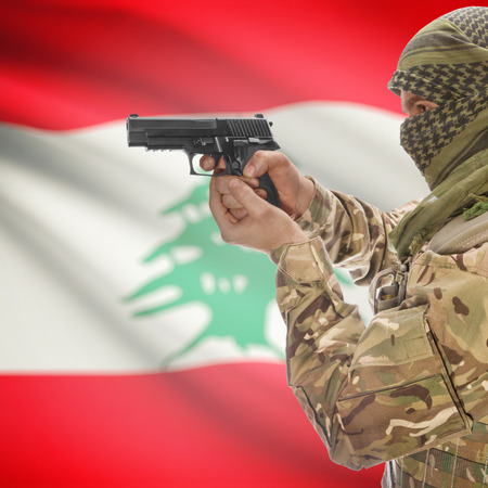 insurgency: Man with gun in hand and national flag on background series - Lebanon