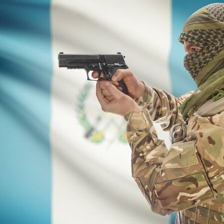 counterterrorism: Man with gun in hand and national flag on background series - Guatemala