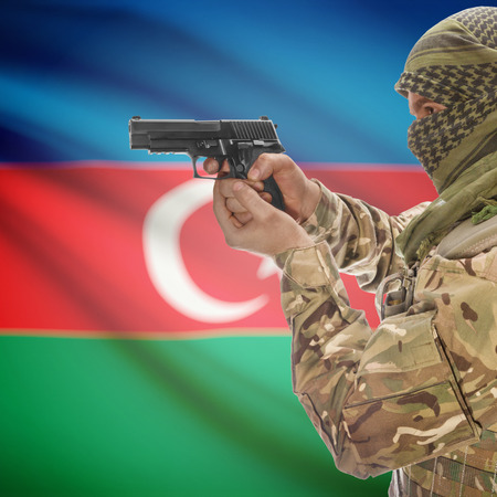insurgency: Man with gun in hand and national flag on background series - Azerbaijan Stock Photo