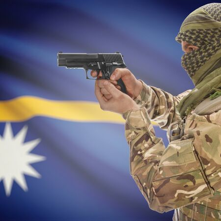 counter terrorism: Man with gun in hand and national flag on background series - Nauru Stock Photo