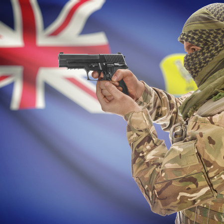 counterterrorism: Man with gun in hand and national flag on background series - Saint Helena Stock Photo