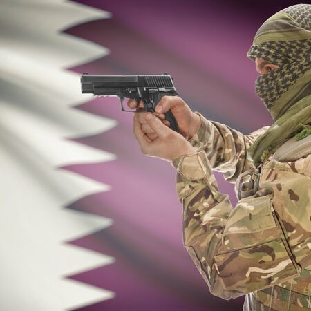 counterterrorism: Man with gun in hand and national flag on background series - Qatar Stock Photo