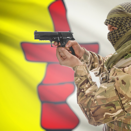 extremist: Male with gun in hand and Canadian province flag on background series - Nunavut Stock Photo