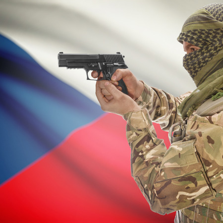 czech: Man with gun in hand and national flag on background series - Czech Republic