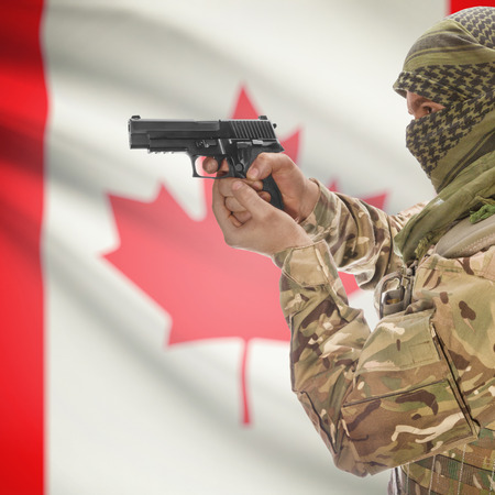 national police agency: Man with gun in hand and national flag on background series - Canada