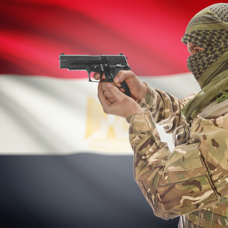counterterrorism: Man with gun in hand and national flag on background series - Egypt