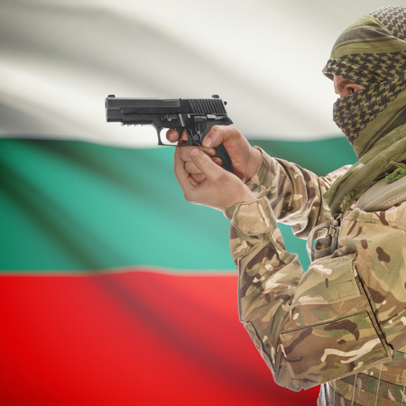 counterterrorism: Man with gun in hand and national flag on background series - Bulgaria