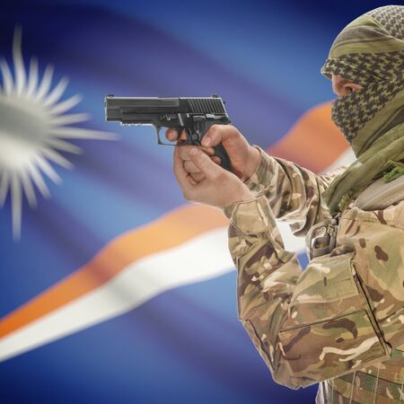 insurgency: Man with gun in hand and national flag on background series - Marshall Islands Stock Photo