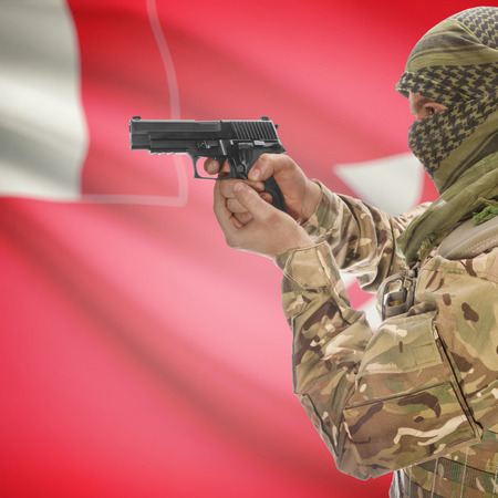 counterterrorism: Man with gun in hand and national flag on background series - Wallis and Futuna