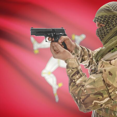 counterterrorism: Man with gun in hand and national flag on background series - Isle of Man Stock Photo