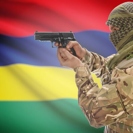 national police agency: Man with gun in hand and national flag on background series - Mauritius