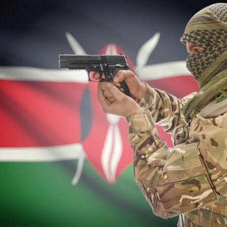 insurgency: Man with gun in hand and national flag on background series - Kenya Stock Photo