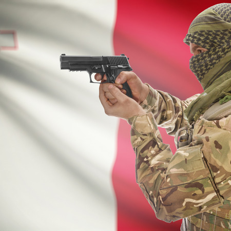 counterterrorism: Man with gun in hand and national flag on background series - Malta