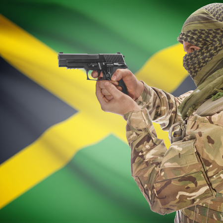 insurgency: Man with gun in hand and national flag on background series - Jamaica