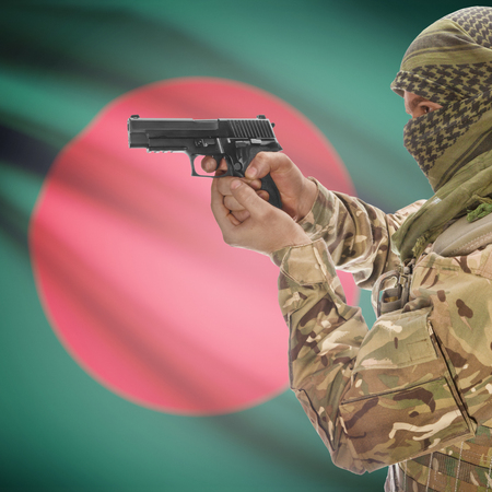 counter terrorism: Man with gun in hand and national flag on background series - Bangladesh