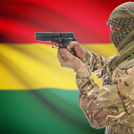 counterterrorism: Man with gun in hand and national flag on background series - Bolivia