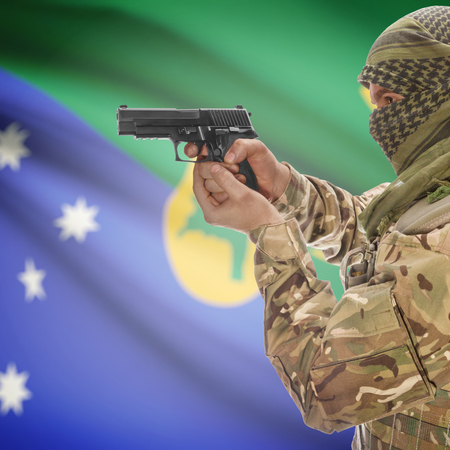 counterterrorism: Man with gun in hand and national flag on background series - Christmas Island