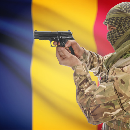 counterterrorism: Man with gun in hand and national flag on background series - Chad