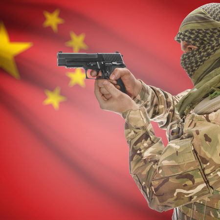 counterterrorism: Man with gun in hand and national flag on background series - China