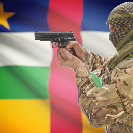 counterterrorism: Man with gun in hand and national flag on background series - Central African Republic
