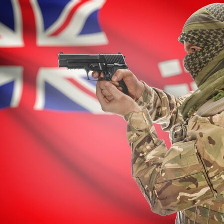manitoba: Male with gun in hand and Canadian province flag on background series - Manitoba Stock Photo