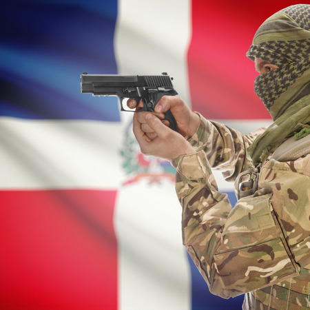 insurgency: Man with gun in hand and national flag on background series - Dominican Republic
