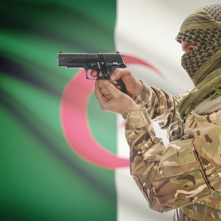 counter terrorism: Man with gun in hand and national flag on background series - Algeria
