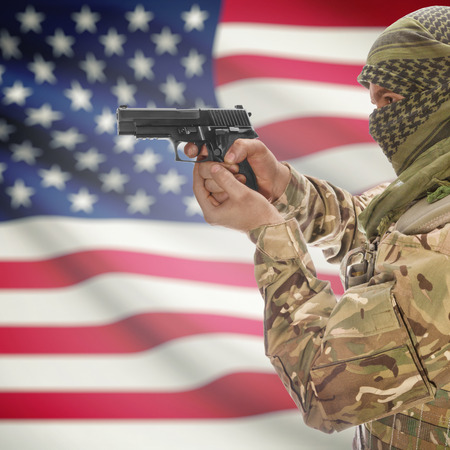counterterrorism: Man with gun in hand and national flag on background series - United States Stock Photo