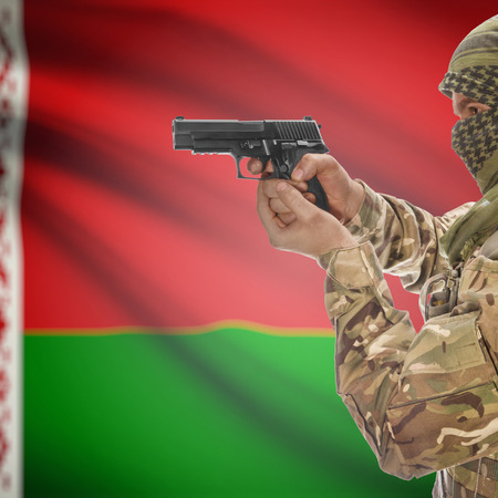 counterterrorism: Man with gun in hand and national flag on background series - Belarus