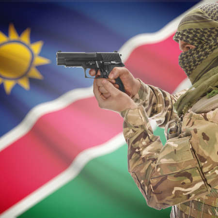 insurgency: Man with gun in hand and national flag on background series - Namibia