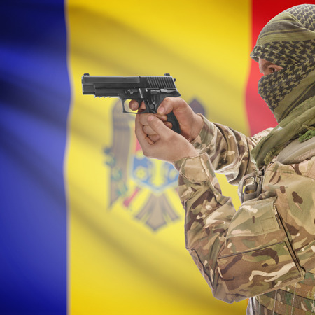 insurgency: Man with gun in hand and national flag on background series - Moldova Stock Photo