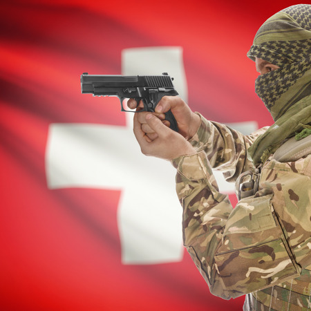 counterterrorism: Man with gun in hand and national flag on background series - Switzerland