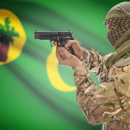 cocos: Man with gun in hand and national flag on background series - Cocos (Keeling) Islands
