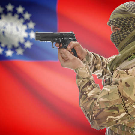 insurgency: Man with gun in hand and national flag on background series - Burma