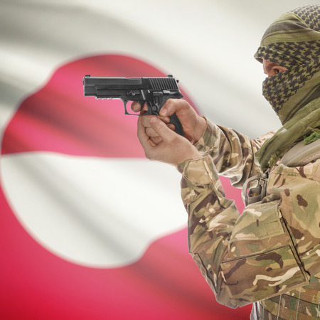 national police agency: Man with gun in hand and national flag on background series - Greenland Stock Photo
