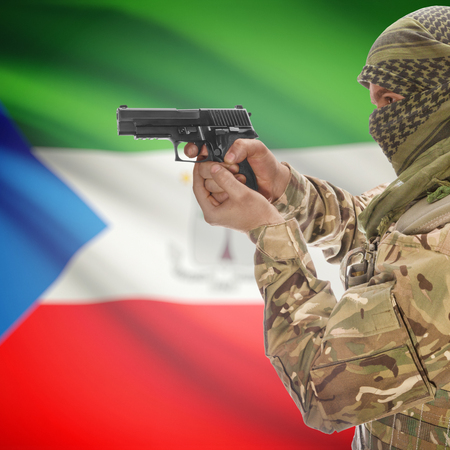 national police agency: Man with gun in hand and national flag on background series - Equatorial Guinea